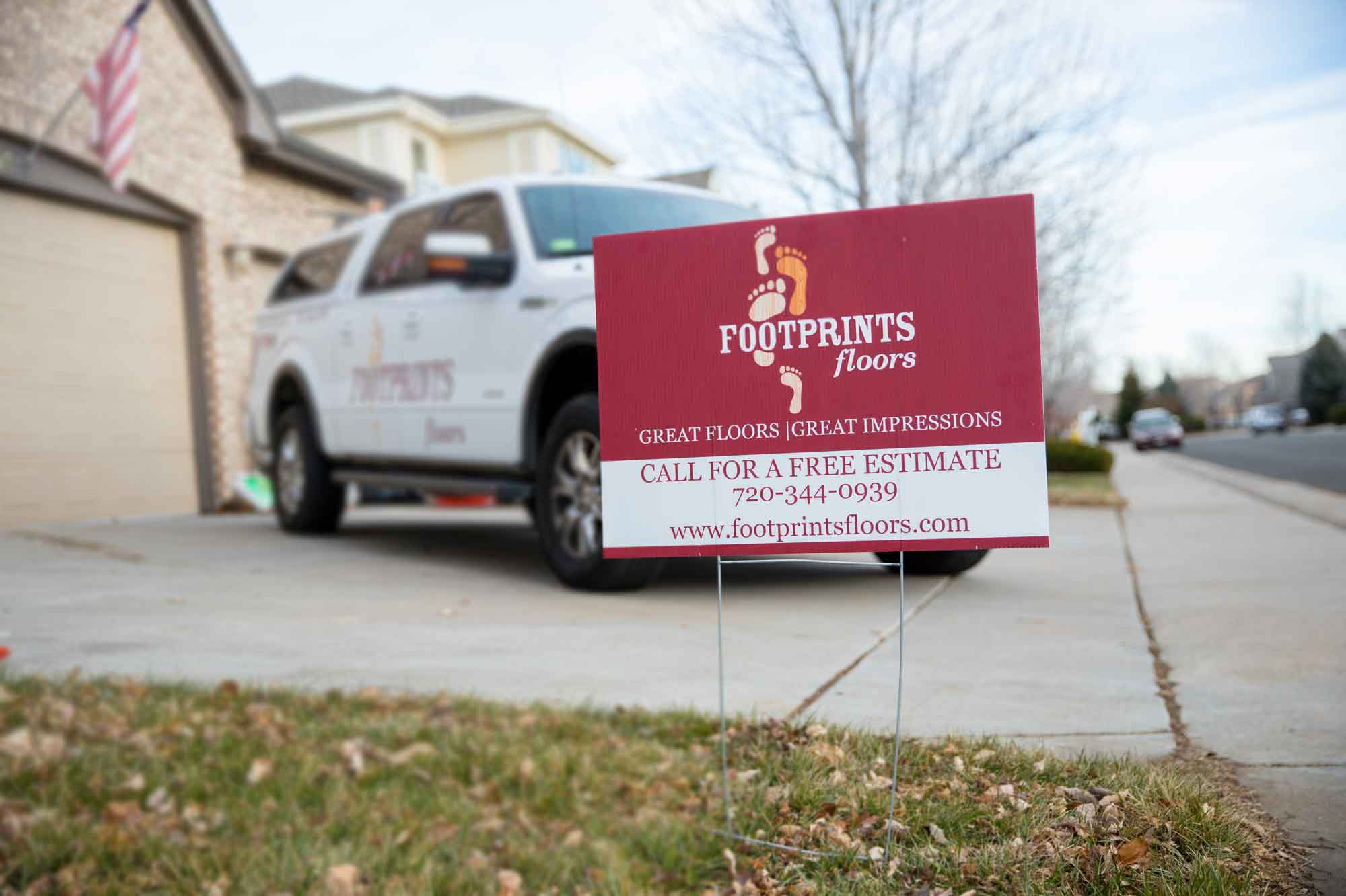 Footprints Floors home improvement franchise sign in front of truck