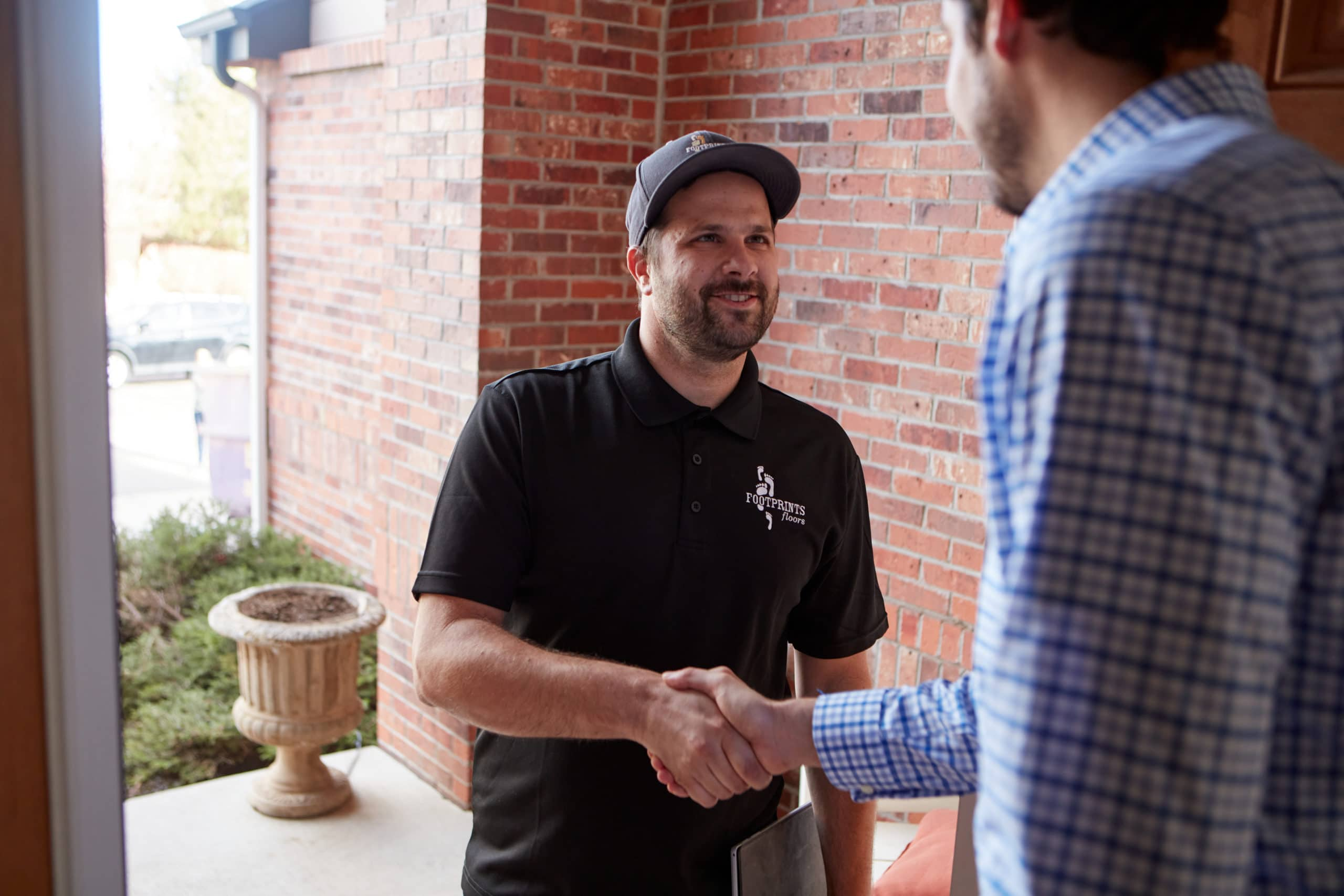 semi absentee franchise owner shaking customer hand