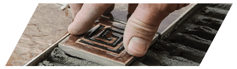 Footprints Floors owners provide professional tile laying services.