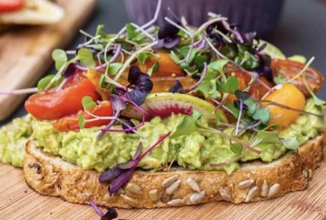 Toastique healthy franchise toast on wooden chopping board.