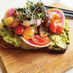 toastique healthy franchises toast on wooden chopping board