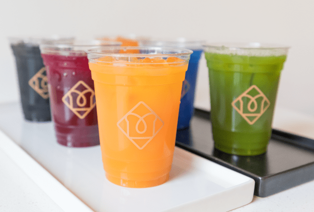 Toastique healthy franchise cups of fresh juice.